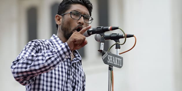 Activist and member of Dalit community, Jignesh Mewani addresses a protest rally against an attack on Dalit caste members in the Gujarat town of Una, in Ahmedabad on July 31, 2016.