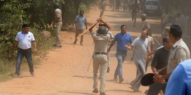 Police use lathis or batons to control protesters, who set fire to liquor shop near Ryan International School, on September 10, 2017 in Gurgaon.