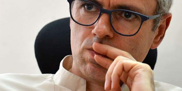 In this photograph taken on July 27, 2016, former Chief Minister of Jammu and Kashmir Omar Abdullah speaks during an interview with AFP at his office in Srinagar.
