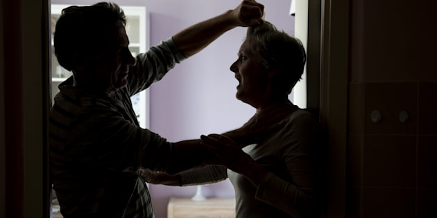 Silhouette of a couple fighting, woman is the victim of domestic violence.