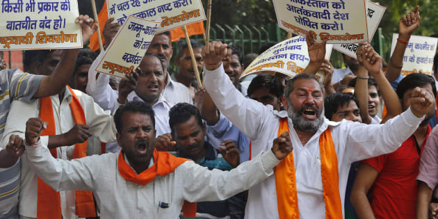 Supporters of Shiv Sena shout slogans during a protest against militant attack in Jammu.