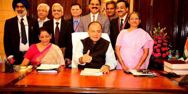 NEW DELHI, INDIA  JULY 9: Arun Jaitley, Minister of Finance, and Nirmala Sitharaman, Minister of State for Finance, with full budget team giving final touches to the Union Budget 2014 on July 9, 2014 in New Delhi, India. (Photo by Pradeep Gaur/Mint via Getty Images)