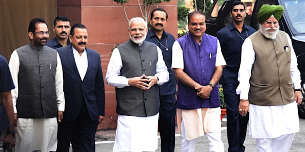 Prime Minster Narendra Modi with Parliament Affairs Minister Anant Kumar, Minister of State for Parliamentary Affairs SS Ahluwalia Mukhtar Abbas Naqvi and Dr. Jitender Singh arrive on the first day of the winter session of Parliament on 16 November 2016 in New Delhi. (Photo by Sonu Mehta/Hindustan Times via Getty Images)