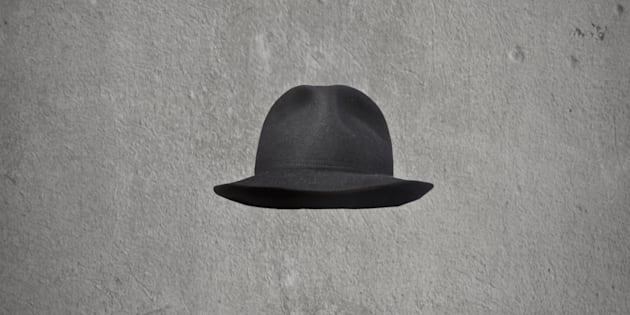 invisible businessman with hat on gray background