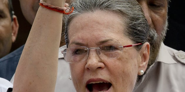 India's opposition Congress party president Sonia Gandhi shouts slogans against the government during a protest in the parliament premises. (AP Photo/ Manish Swarup)