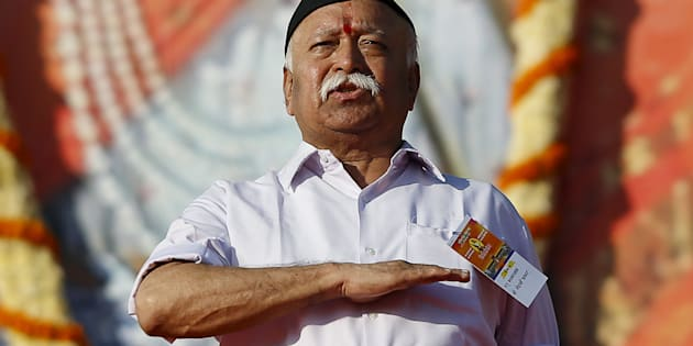 Mohan Bhagwat, chief of Rashtriya Swayamsevak Sangh (RSS), gestures as he prays during a conclave on the outskirts of Pune, India, January 3, 2016.