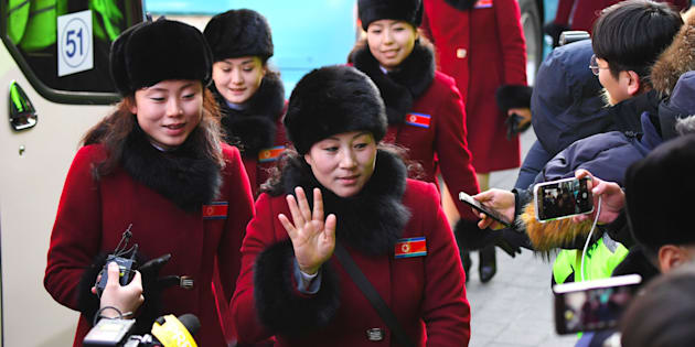 North Korean cheerleaders arrive at the Inje Speedium, a racetrack and hotel complex, in Inje, north of Pyeongchang, on February 7, 2018 ahead of the Pyeongchang Winter Olympic Games.