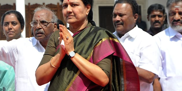 General secretary of southern Tamil Nadu state's ruling All India Anna Dravida Munnetra Kazhagam (AIADMK), VK Sasikala (C) gestures to cadres on her arrival to take up office at the AIADMK headquarters in Chennai on December 31, 2016.