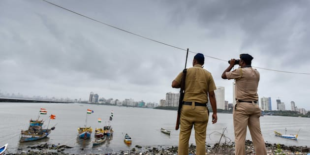 Police Commandos stand guard by the sea coast at Geeta Nagar Colaba due to high alert after a group of men was spotted moving suspiciously near a Naval base at Uran, on September 23, 2016 in Mumbai, India.