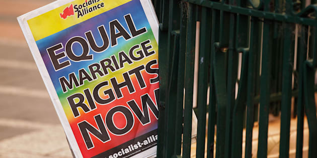 Protesters gathered outside Sydney Town Hall in support of marriage equality.