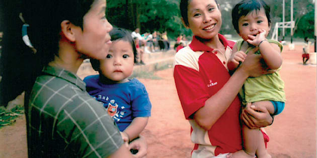 Sarita Devi (right) with Mary Kom and her twins.