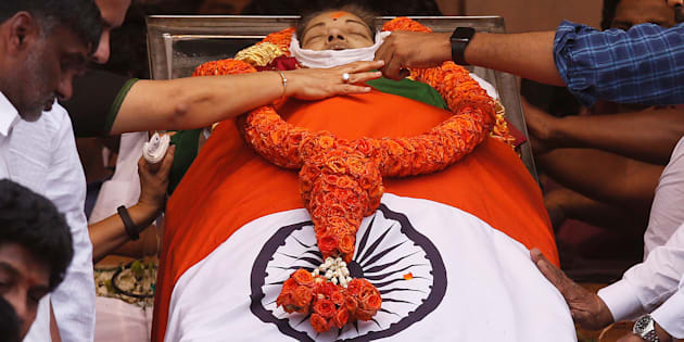 People pay homage to the body of Tamil Nadu Chief Minister Jayalalithaa Jayaraman, who died on Monday, in Chennai, India December 6, 2016. REUTERS/Adnan Abidi