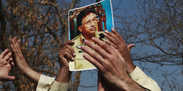 A supporter holds a picture of former Pakistani President Pervez Musharraf, during a protest with others at the Special Court where Musharraf will attend his trial in Islamabad February 18, 2014.