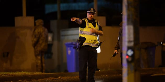 An armed police officer at the scene in the Melbourne bayside suburb of Brighton on Monday night.