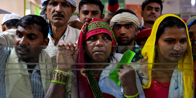 Villagers wait inside the bank to make the transactions in Basendua village in Bulandshahr in northern Uttar Pradesh. (CHANDAN KHANNA/AFP/Getty Images)