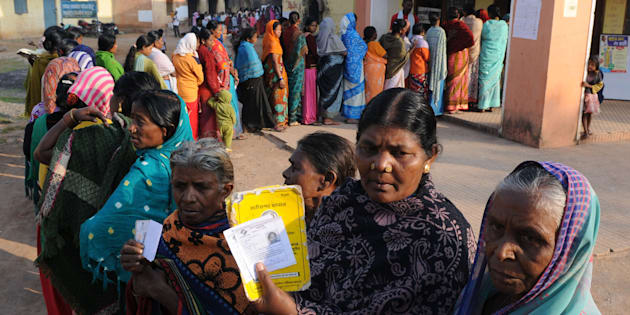 Voters showing their ID cards at a polling booth during the first phase of assembly elections of Chhattisgarh in Jagadalpur, November 2013, in Bastar. (Photo by Parwaz Khan/Hindustan Times via Getty Images)