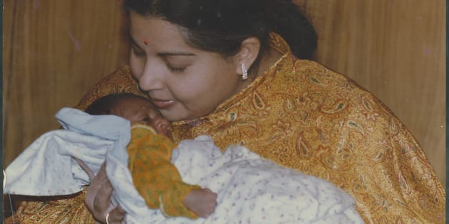 File Photo of AIADMK leader and Tamil Nadu Chief Minister J Jayalalithaa with an infant on May 19, 1995 in Chennai.