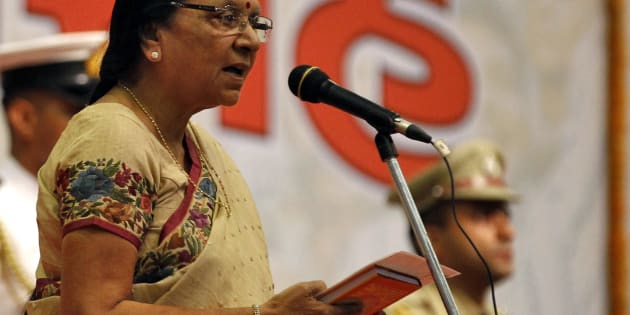 Anandiben Patel, chief minister of Gujarat, takes her oath during a swearing-in ceremony at Gandhinagar in Gujarat May 22, 2014.