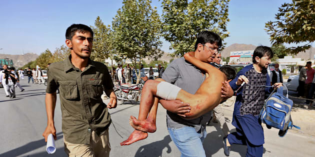 An injured boy is carried to a hospital after an explosion struck a protest in Kabul, Afghanistan, Saturday, July 23, 2016. Witnesses in Kabul say that an explosion struck the protest march by members of Afghanistan's largely Shiite Hazara ethnic minority group, demanding that a major regional electric power line be routed through their impoverished home province. (AP Photo/Rahmat Gul)