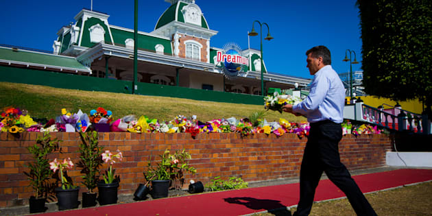 Dreamworld CEO Craig Davidson lays flowers at a makeshift floral tribute at the theme park on the Gold Coast on October 26.
