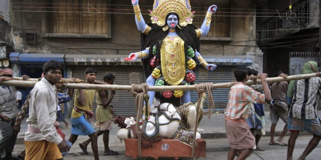 An image of Hindu goddess Kali is carried by workers towards a worship venue, in Calcutta, India, Thursday, Nov. 8, 2007. (AP Photo/Bikas Das)