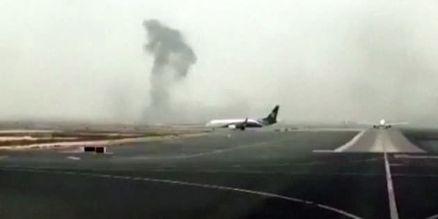 This image is from video shows smoke rising after an Emirates flight crash landed at Dubai International Airport on Wednesday.