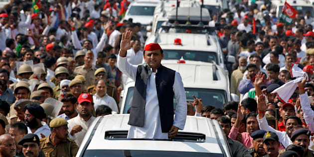 Akhilesh Yadav, Chief Minister of the northern state of Uttar Pradesh and the son of Samajwadi Party (SP) chief Mulayam Singh Yadav, waves at his supporters during a Rath Yatra, or a chariot journey, as part of an election campaign in Lucknow, India November 3, 2016. REUTERS/Pawan Kumar