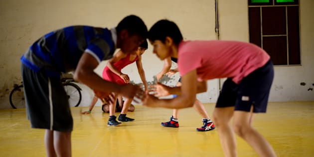 A training session at Balali akhara features both boys and girls. Wrestler sisters Babita and Sangita Phogat come from this village. As many as six girls from their family have won gold medals at various international events. Photo by Pradeep Gaur/Mint via Getty Images)