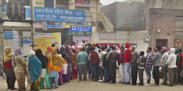 Despite cold weather people queuing outside the State Bank of India branch to get cash at Batala Road on December 29, 2016 in Amritsar.