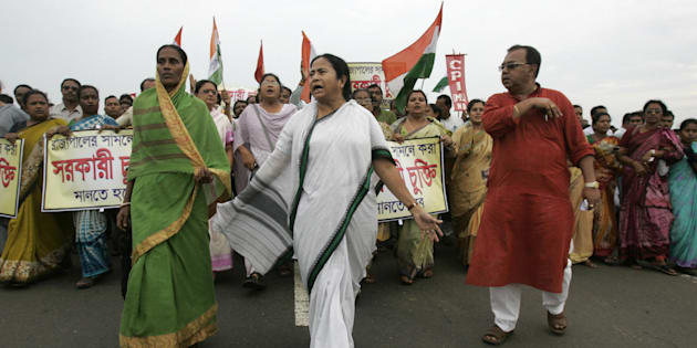 File photo of leader of India's Trinamool Congress (TMC) party Mamata Banerjee (C) marching beside the unfinished Tata Motors plant at Singur on September 26, 2008.