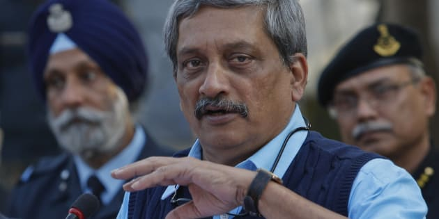 Indian Defense Minister Manohar Parrikar addresses the media at the Indian air force base in Pathankot.