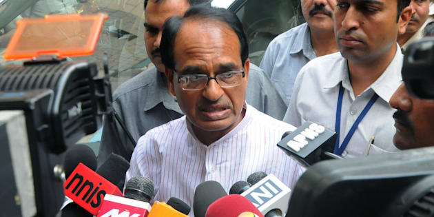 Chief Minister of the state of Madhya Pradesh Shivraj Singh Chauhan talks to media outside the Ministry of External Affairs in New Delhi on July 8, 2015.