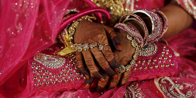 A Muslim bride waits for the start of a mass marriage ceremony in Mumbai, India, January 27, 2016.