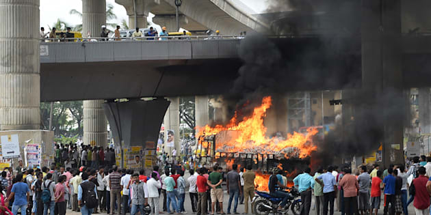 A vehicle is set alight by pro-Karnataka activists as the Cauvery water dispute erupted following the Supreme Court's order to release water to Tamil Nadu, in Bangalore on September 12, 2016. MANJUNATH KIRAN/AFP/Getty Images.