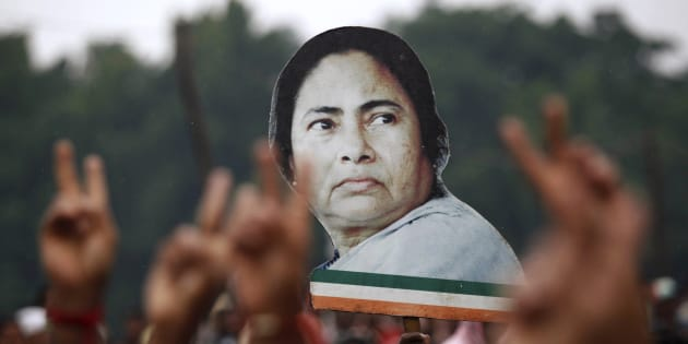 Supporters hold a cut-out of chief minister Mamata Banerjee during a rally in Kolkata in 2011.