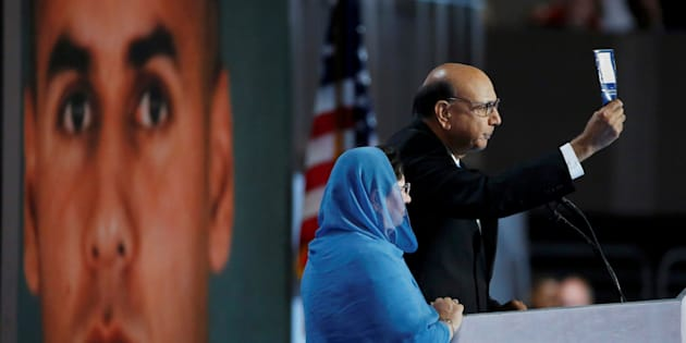PHILADELPHIA, PA - JULY 28:  Khizr Khan, father of deceased U.S. Army Capt. Humayun S. M. Khan, delivers remarks as he is joined by his wife Ghazala Khan on the fourth day of the Democratic National Convention at the Wells Fargo Center, July 28, 2016 in Philadelphia, Pennsylvania. Democratic presidential candidate Hillary Clinton received the number of votes needed to secure the party's nomination. An estimated 50,000 people are expected in Philadelphia, including hundreds of protesters and members of the media. The four-day Democratic National Convention kicked off July 25. (Photo by Joe Raedle/Getty Images)