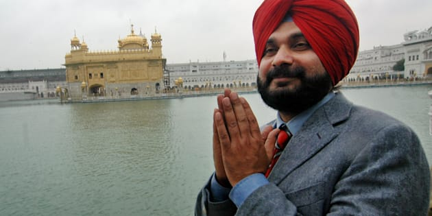 File photo of cricketer-turned-politician Navjot Singh Sidhu prays in front of the Golden Temple, after his victory in Amritsar, India, Tuesday, Feb. 27, 2007.