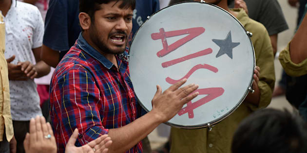 JNUSU President Kanhaiya Kumar protests as he was fined of ₹10,000 by the authorities of JNU High Level Committee in front of the administrative block, on 26 April 2016 in New Delhi. (Photo by Vipin Kumar/Hindustan Times via Getty Images)