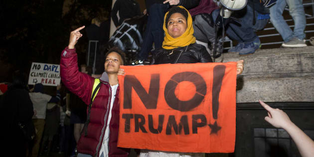 Protesters hold up signs and yell during a protest against the election of Donald Trump in the Boston Common on November 9, 2016 in Boston, Massachusetts. (Photo by Scott Eisen/Getty Images)