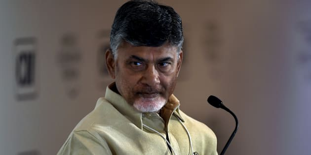 Chief Minister of Andhra Pradesh, N. Chandrababu Naidu looks on as he attends the session 'Cities as Engines of Growth' during the second day of the India Economic Summit in New Delhi on October 7, 2016. / AFP / MONEY SHARMA        (Photo credit should read MONEY SHARMA/AFP/Getty Images)