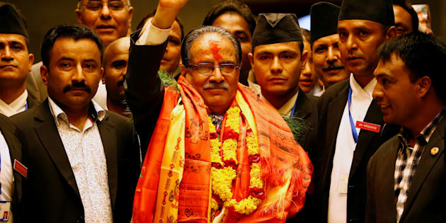 Nepal's newly elected Prime Minister Pushpa Kamal Dahal, also known as Prachanda, waves towards the media after he was elected Nepal's 24th prime minister in 26 years, in Kathmandu, Nepal, August 3, 2016. REUTERS/Navesh Chitrakar TPX IMAGES OF THE DAY