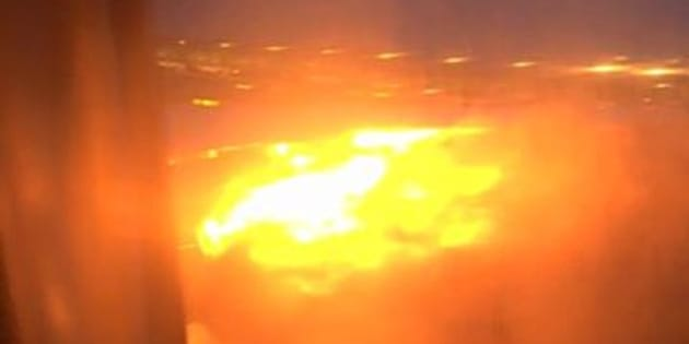 A still image of the plane's wing on fire.