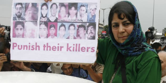 Mehbooba Mufti, chief of People's Democratic Party (PDP) Kashmir's main opposition party, shows pictures of killed youths during a protest in Srinagar July 29, 2010.