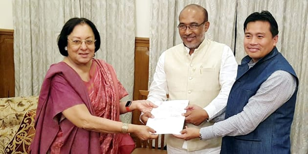 Manipur Governor Najma Heptulla handing over the invitation letter to BJP leader Nongthombam Biren Singh to form the government of Manipur at Raj Bhavan, Imphal, Manipur on Tuesday.
