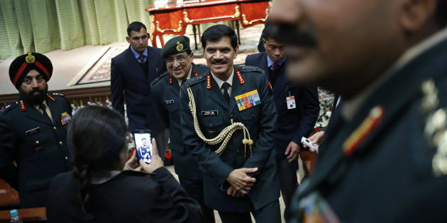 File photo of Indian Army chief General Dalbir Singh (C) leaves the venue after addressing a news conference in New Delhi on 13 January, 2015.