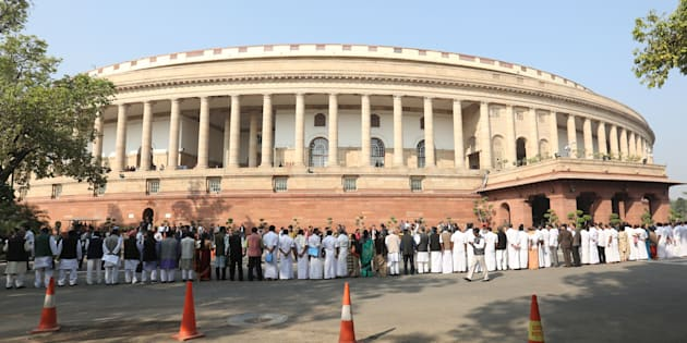 Indian opposition politicians take part in a protest calling for Prime Minister Narendra Modi to attend parliament over the ongoing demonitisation process at Parliament House in New Delhi on November 23, 2016. (STR/AFP/Getty Images)