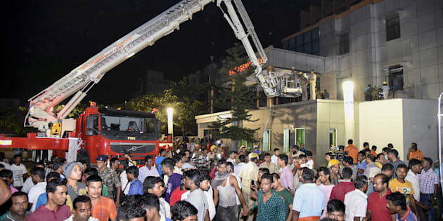 This photograph taken on October 17, shows Indian rescue workers trying help victims of a massive fire at the SUM hospital building in Bhubaneswar, the capital of coastal Odisha state.