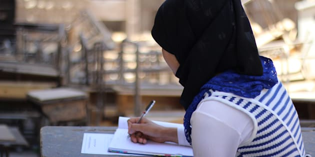 Rama studying in an accommodation centre where she stayed during exam period.