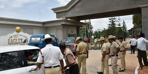 Police frisking cars going inside The Golf Village Eagleton resort as Congress MLAs from Gujarat are staying here at Bidadi outside on July 29, 2017 in Bengaluru.