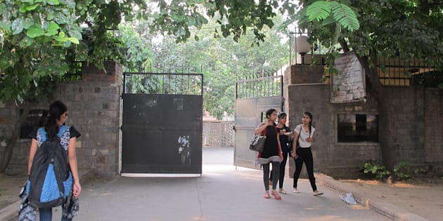 Students in at the gate of the women's dorm of Miranda House, a women's college in Delhi University. In the new, growing campus campaign in New Delhi's colleges called 'Break The Cage', students are protesting strict against women-only dorm rules that bar women from going out at late hours.